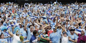 Uruguay supporters cheer for their national team during the group D World Cup soccer match between Italy and Uruguay at the Arena das Dunas in Natal, Brazil, Tuesday, June 24, 2014. (AP Photo/Petr David Josek)